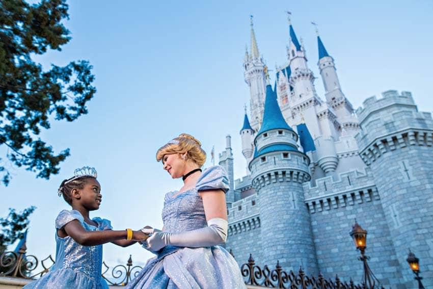 Cinderella and Small Child in front of Magic Kingdom Cinderella Castle