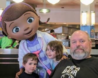 Father, son and daughter with Disney character